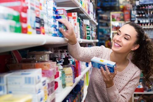 choosing toothpaste on store shelf
