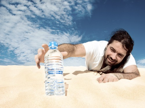 man crawls through desert for bottled water