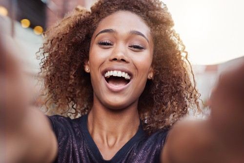 young woman in smiling selfie