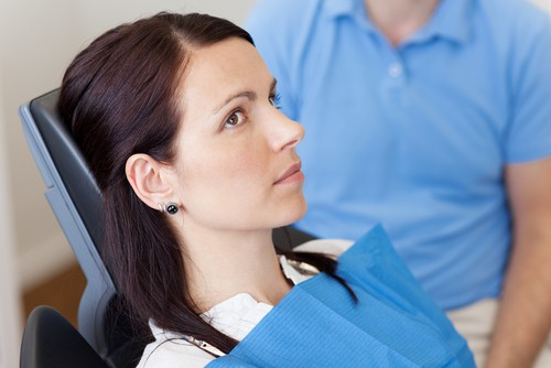 anxious woman in dental chair
